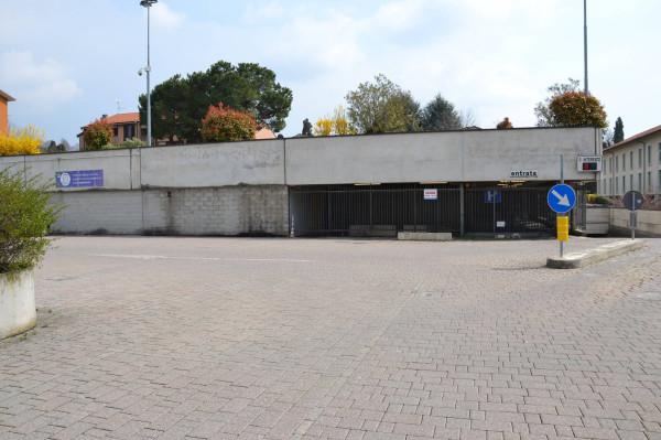 garage-Box-posto auto  in Vendita a Merate