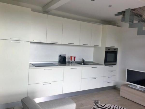 Appartamento in affitto a Angera, 2 locali, prezzo € 650 | Cambio Casa.it